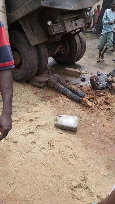A mechanic Crushed by Tiper in His Own Work Shop