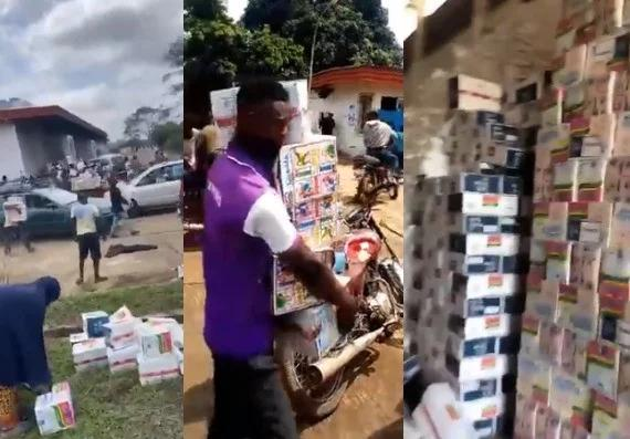 Osun state residents cart away COVID19 palliatives stored in the Cocoa Processing Industry warehouse