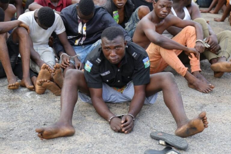Police parade hoodlum who attacked a police station and went away with the DPO's uniform